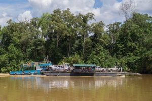 Transporting cars by barge on the Kinabatangan River