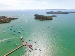 The jetty at Ao Po, with (top left) Ao Po Grand Marina & (right) first Koh Raet, then Koh Naka Yai - Image courtesy of Lee Marine International Marine Brokerage. Photographer: Jim Poulsen