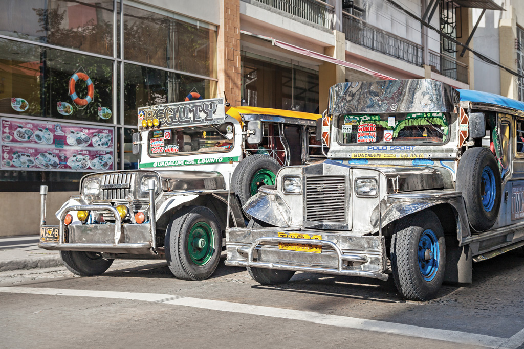 Jeepneys, the most popular means of public transport in the Philippines - Photo by saiko3p/Shutterstock.com