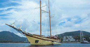 Superyachts anchored off Kata Rocks
