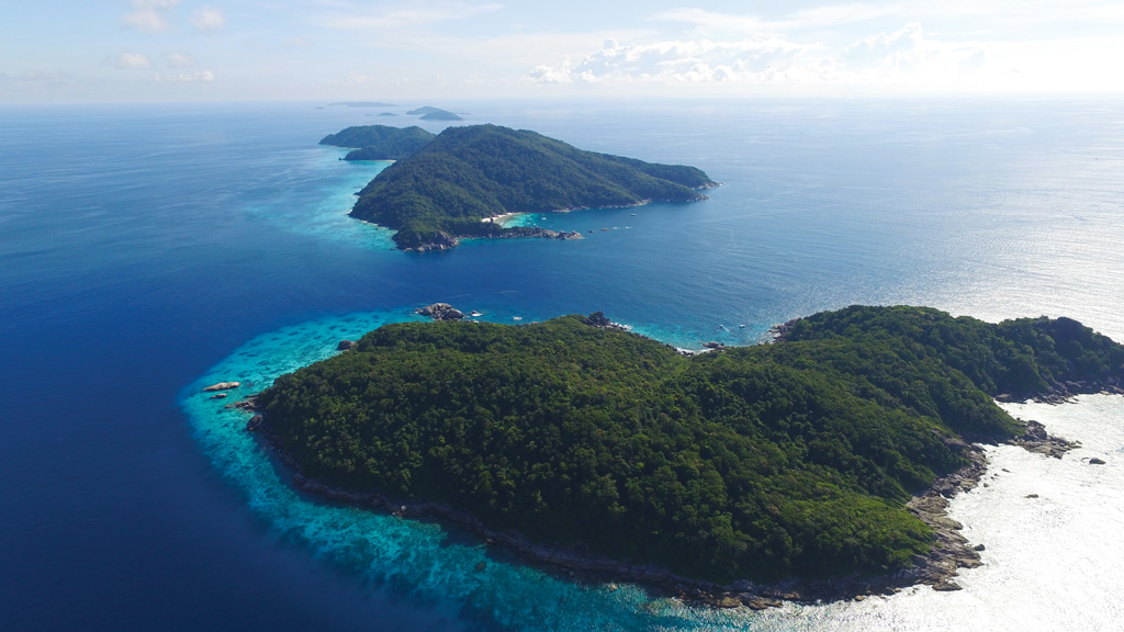 The Similans, north to south (Island #9 to #1) - Photo by Image courtesy of Lee Marine International Marine Brokerage. Photographer: Jim Poulsen
