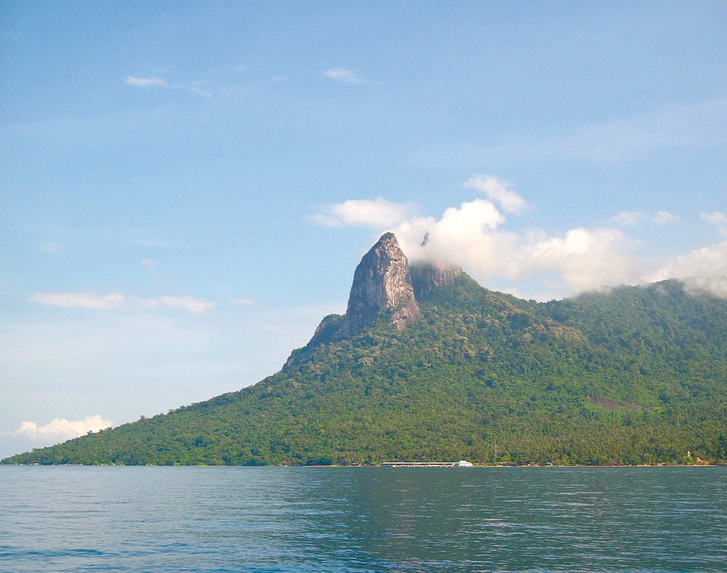 The distinctive twin peaks 'Donkey's Ears' at the South Tioman anchorage - Photo by Bill OLeary