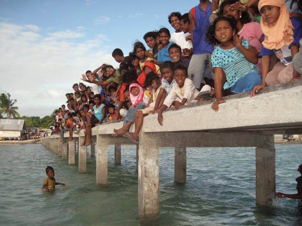 Indonesian kids on a jetty