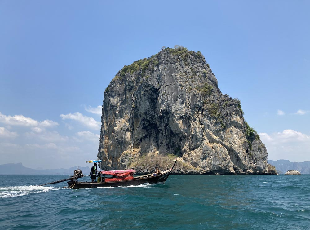 Longtail boat passing in front of Koh Ma Tang Ming