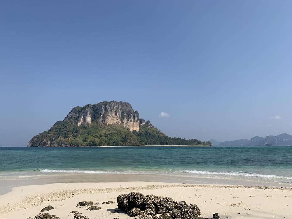 Koh Poda from Koh Tup with rocks in the foreground