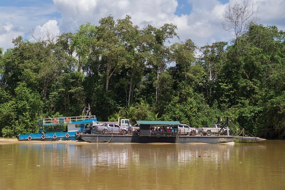 Car transport on the Kinabatangan River in Sabah, Malaysia
