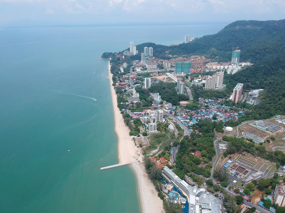 Drone shot of the long beach at Batu Ferringhi