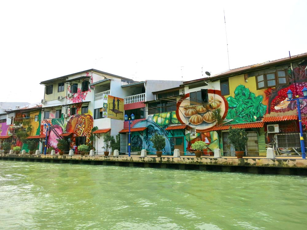 Colourful murals on buildings lining the Malacca River