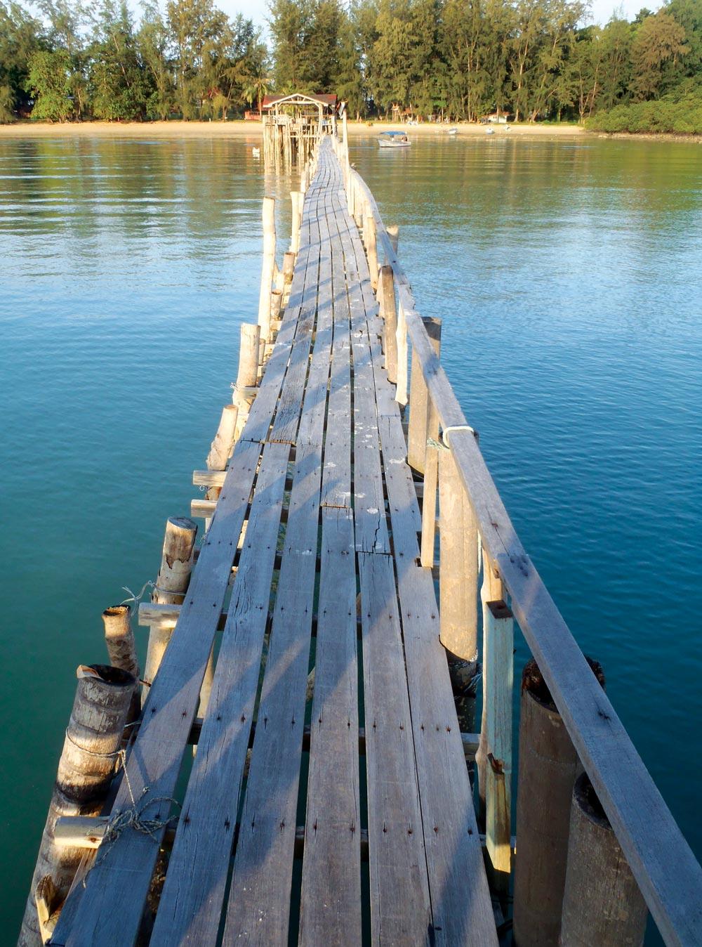 Simple wooden jetty at Pulau Sibu east