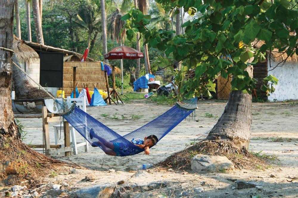 Kid asleep in a hammock on Koh Mak