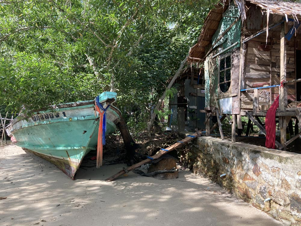 Koh Yao Noi is full of charming tableaus like this old wooden boat and the rickety oceanside bungalow