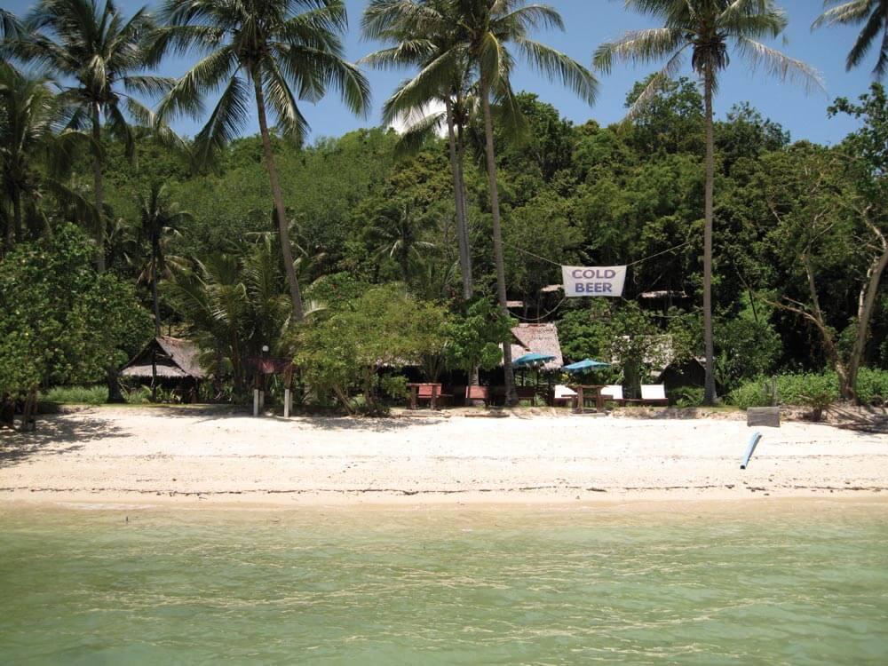 Cold beer sign at Koh Naka Yai northeast beach