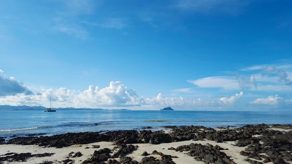 Koh Naka Yai's east coast is peaceful before the day trip speedboats arrive
