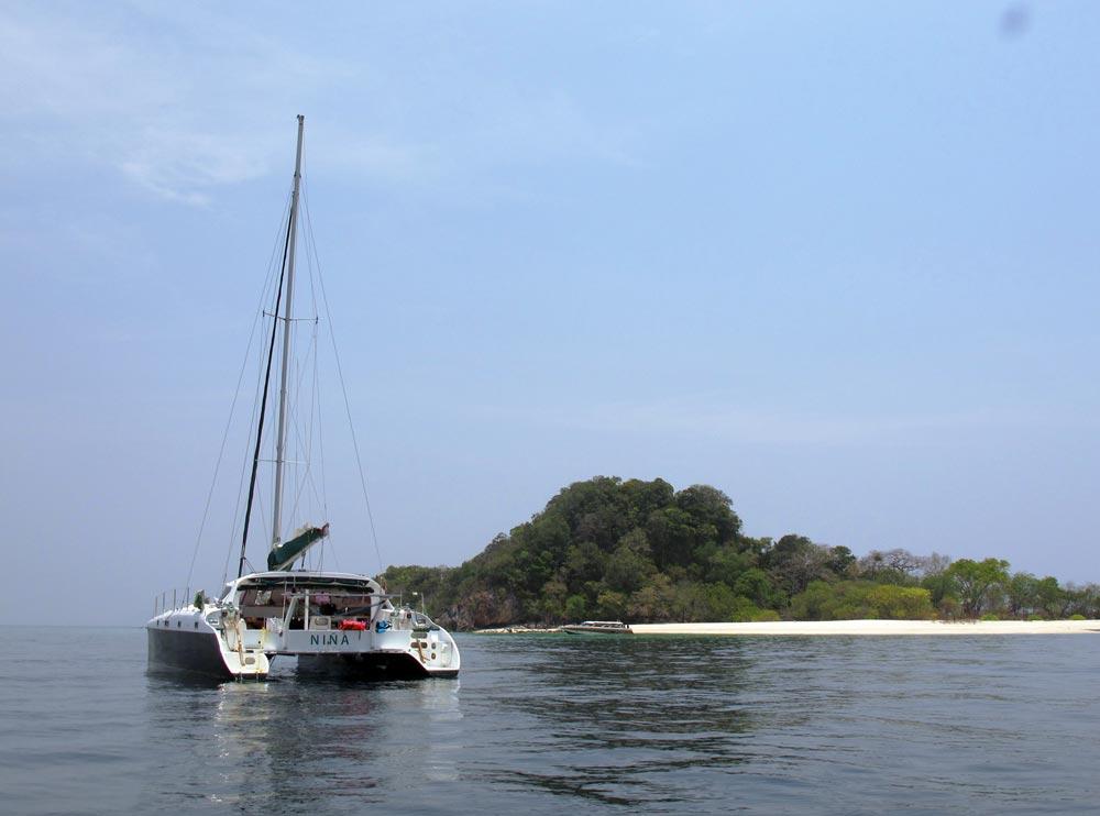 Catamaran Nina crew waiting for the lone speedboat to head somewhere 'civilised' for lunch, leaving Koh Chuku deserted.